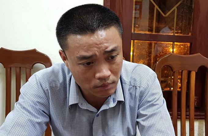 Phạm Xuân Lân tại cơ quan điều tra. Ảnh: Sơn Hà