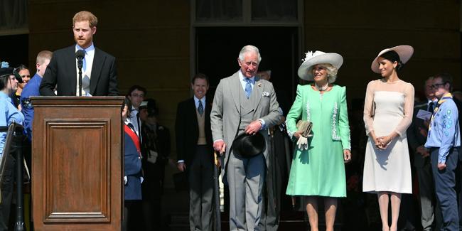 Vợ chồng Harry - Meghan góp mặt trong buổi tiệc như một sự kiện hoàng gia chính thức họ tham dự sau cưới. Ảnh: Harpers Bazaar.