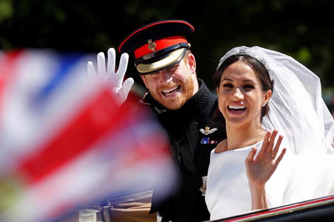 Vợ chồng Hoàng tử Harry trong đám cưới cổ tích hôm 19/5. Ảnh: Reuters.