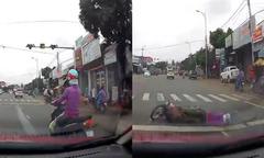 'Nữ Ninja' nằm đau đớn vì sang đường ẩu bị ôtô tông
