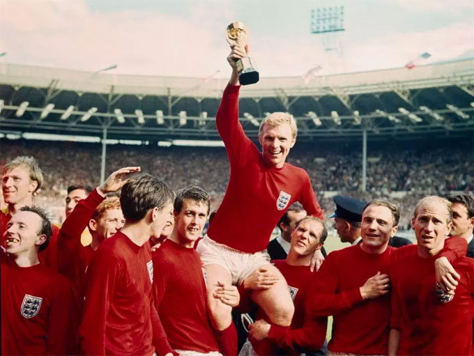 England legend Bobby Moore celebrates in 1966 with his World Cup-winning teammates
