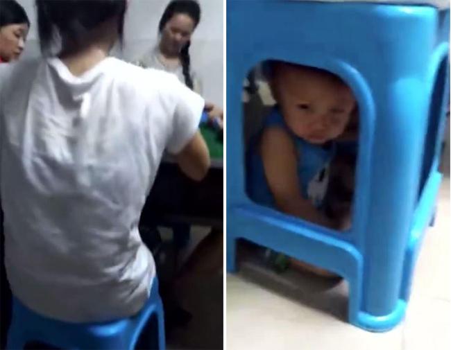 Người mẹ chơi bài mặc con khóc dưới ghế. Ảnh cắt từ video.