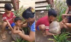 Mẹ loay hoay giải cứu con trai mắc kẹt trong chum