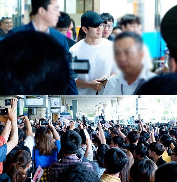 Khán giả chen chúc để được nhìn thấy Jung Hae In ở sân bay Tân Sơn Nhất. Ảnh: iOne