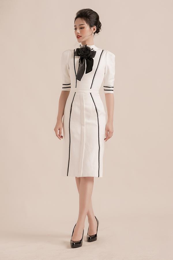 Nhà thiết kế Đỗ Long cũng khéo léo tạo những những đường cắt, gấp nếp trở thành họa tiết cho trang phục.