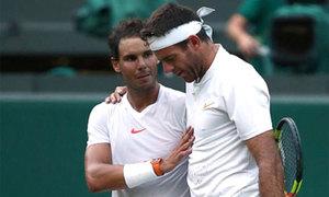 Nadal đi đến ôm đối thủ nằm bẹp vì thua trận