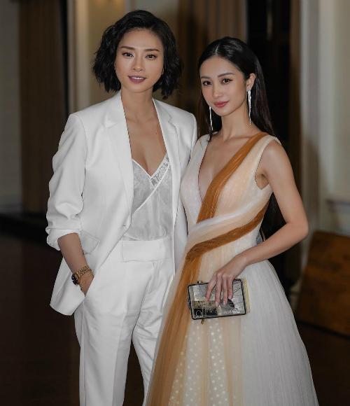 Ngô Thanh Vân với thần thái khỏe khoắn, cá tính. Trong khi Jun Vũ dịu dàng với đầm công chúa khoét cổ sâu khi xuất hiện chung tại một sự kiện tại TP HCM.