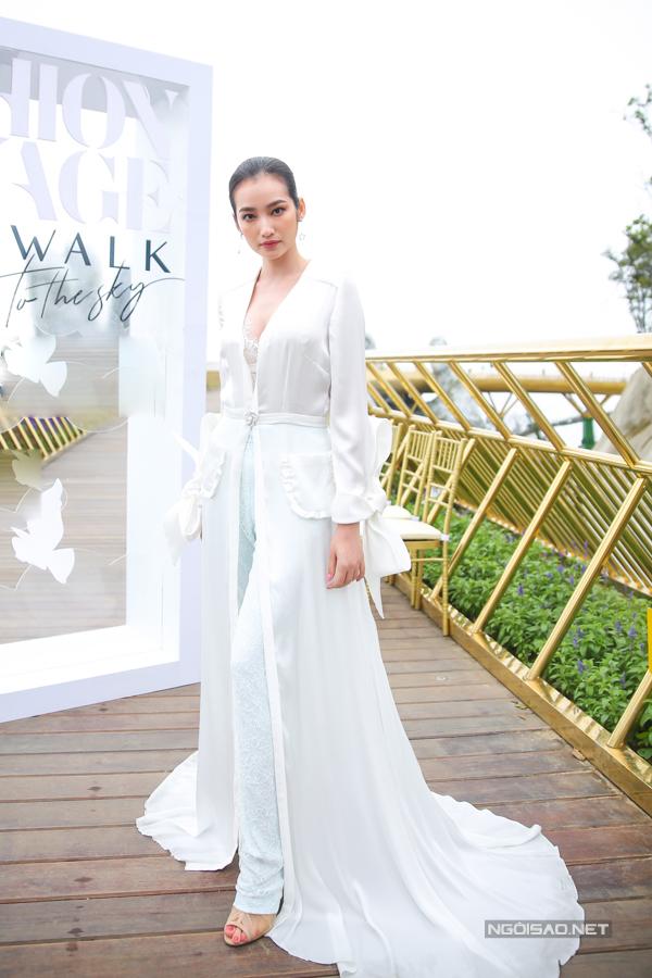 Trúc Diễm chọn suit được tiết tấu bắt mắt khi trở lại làng thời trang Việt.