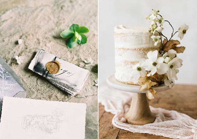 Bánh cưới được trang trí bởi hoa tươi màu trắng, nâu sậm và được đặt trên đế gỗ màu nâu.