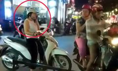 Người phụ nữ dừng xe giữa ngã tư 'buôn' điện thoại