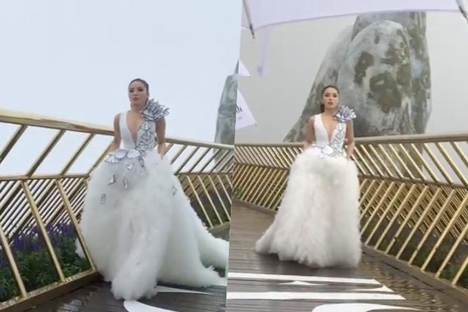 Hoa hậu Kỳ Duyên catwalk trong cơn mưa lớn.