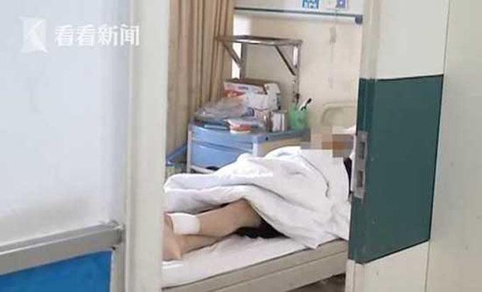Li hiện điều trị trong bệnh viện thành phố Nam Xương, tỉnh Giang Tây. Ảnh: Jiangxi TV.