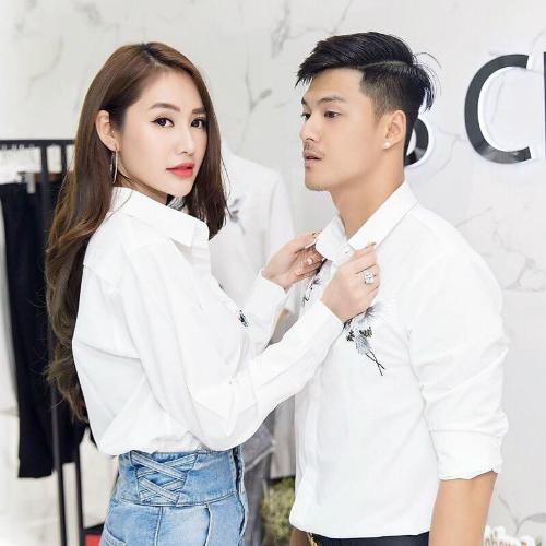 Linh Chi sửa áo cho Lâm Vinh Hải khi đi mua sắm.