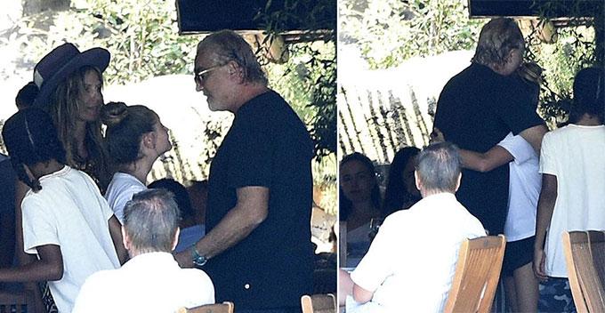 Heidi Klum (đội mũ) mỉm cười nhìn con gái gặp mặt cha đẻ vào cuối tháng 7.