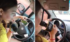 Cô gái vừa lái xe ôtô vừa hát karaoke