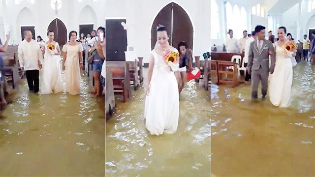 Cô dâu Jobel Delos Angeles mặc váy cưới lội nước trong nhà thờ thuộc thị trấn Hagonoy, Philippines, hôm 11.8. Ảnh chụp từ video.