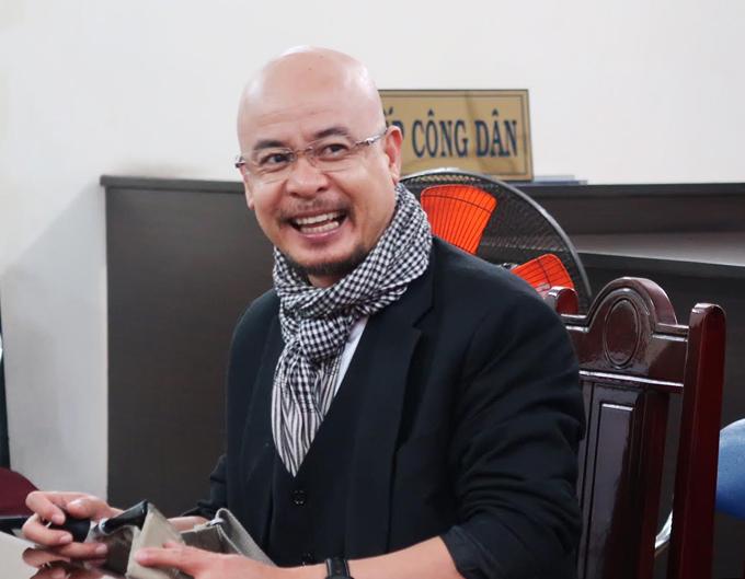 Ông Đặng Lê Nguyên Vũ trong phiên hòa giải ly hôn sáng 14/8. Ảnh: Lan Ngọc.