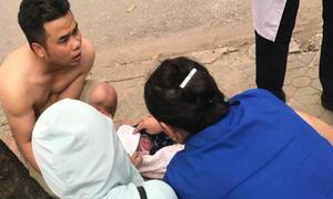 Chồng 9X đỡ đẻ cho vợ trên phố, con gái chào đời trong 7 giây