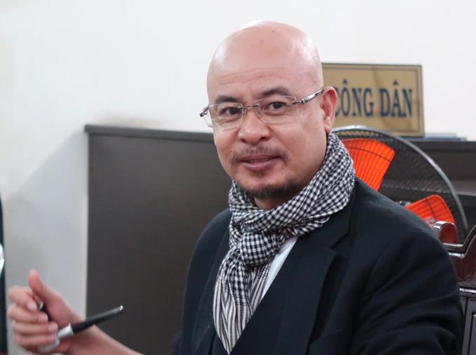 Ông Đặng Lê Nguyên Vũ trong phiên hòa giải ly hôn lần hai hôm 14/8. Ảnh: Lan Ngọc.