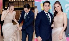 Hứa Vĩ Văn nâng váy cho Phương Anh Đào trong buổi ra mắt phim