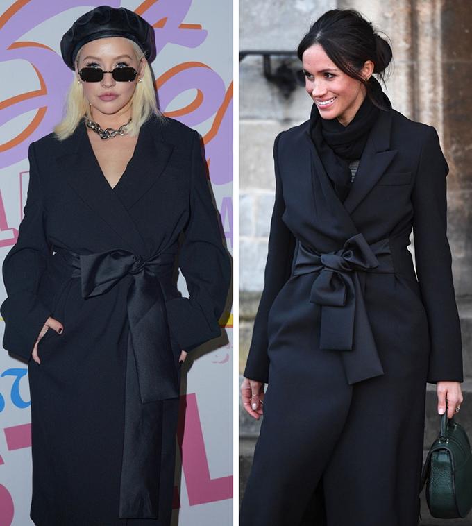 Với mẫu áo choàng buộc nơ gam đen, Nữ công tước Meghan Markle (phải) quàng thêm khăn để tạo nên set đồ ấm áp, trong khi ca sĩ Christina Aguilera kết hợp mũ nồi và  vòng cổ dây xích to bản, khắc hoạ hình ảnh cá tính.