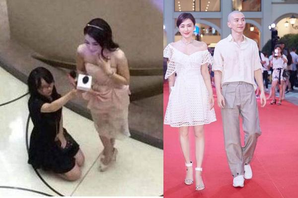 Hành động bắt nhân viên quỳ xuống cầm mic của người đẹp (ảnh bên phải), Tần Lam sánh đôi người yêu tin đồn Vương Quan Dật tại Liên hoan phim.