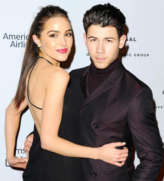 Olivia và Nick Jonas trong sự kiện năm 2013.