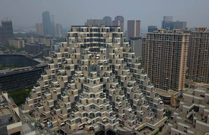 The quirky 10-storey building is located in Kunshan, China, and has become a trending topic among web users