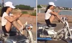 Nữ sinh xăm trổ lái xe máy bằng chân lao vun vút trên đường