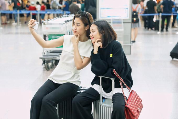 Hoa hậu Đỗ Mỹ Linh đọ mặt mộc với Phương Ly ở sân bay - 9