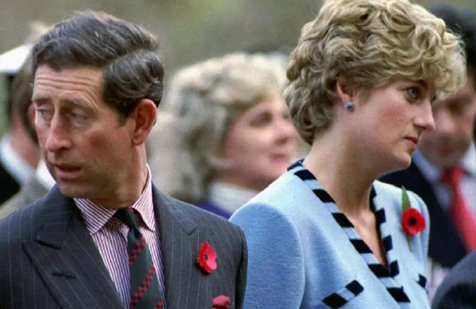 Princess Diana and Prince Charles look in different directions during a Korean War commemorative service in November 1992. Britains Queen Elizabeth ordered her son Prince Charles and Princess Diana to divorce, rather than maintain a married separation, according to Dianas former butler.