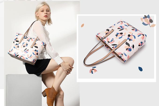 Túi tote Venuco Madrid hoa văn: Với ưu điểm tiện dụng, phối cùng hàng loạt kiểu đồ khác nhau, nên chiếc túi này đang được nhiều chị em tin dùng. Sản phẩm giảm giá 30% còn 1,59 triệu đồng.