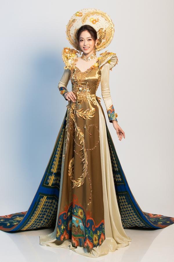 Á hậu Bùi Phương Nga chọn áo dài làm trang phục truyền thống dự thi Hoa hậu Hòa bình quốc tế 2018 tại Myanmar. Bộ trang phục có tên gọi Ngũ Phụng Tề Phi, tông chủ đạo màu vàng, có chất liệu gấm kết hợp lụa, mang ý tưởng về hình tượng Ngũ Phụng và pháp lam Huế. Nhà thiết kế Khánh Shyna đảm nhận thực hiện trang phục.