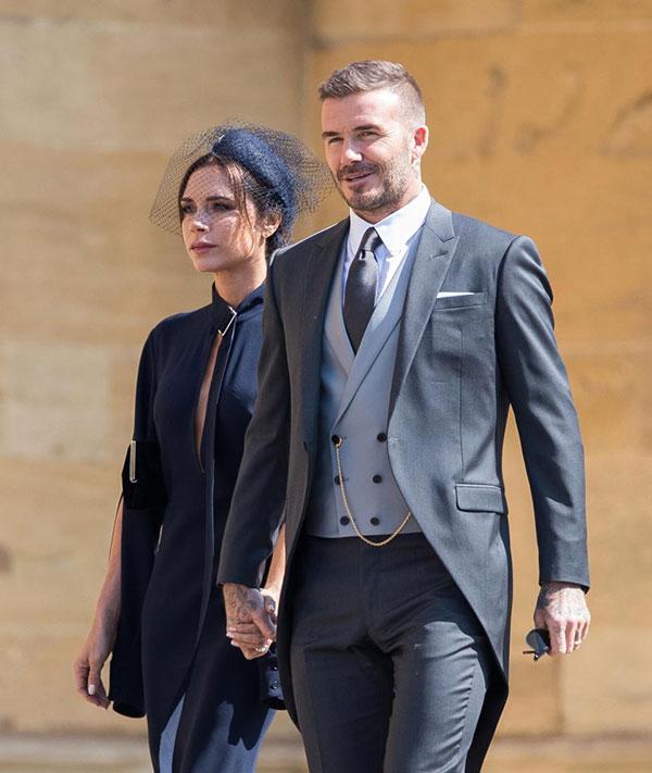 Vợ chồng Davide Beckham sánh đôi dự đám cưới của Hoàng tử Harry hôm 19/5 ở lâu đài Windsor. Ảnh: UK Press.
