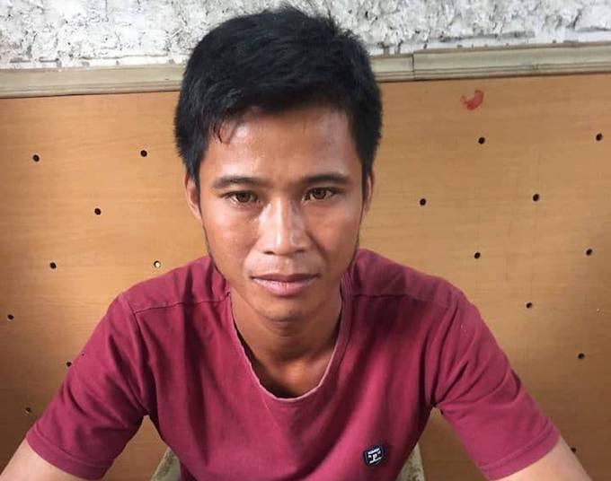 Trần Văn Hoa tại cơ quan công an.