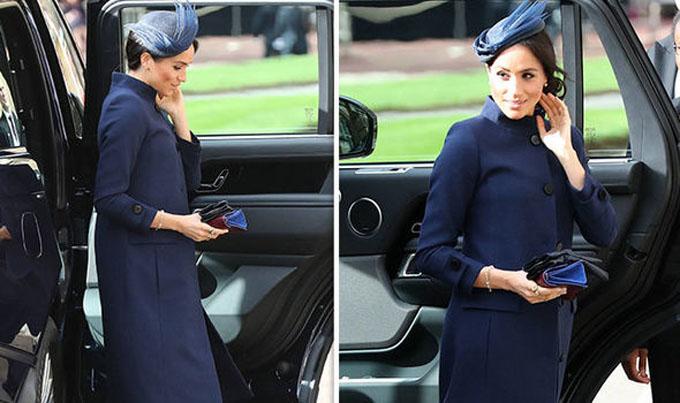 Meghan bị nghimang thai khi diện áo khoác rộng dự đám cưới Công chúa Eugenie hôm 12/10. Ảnh: EPA.