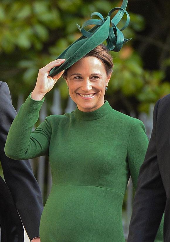 Pippa bụng bầu gần sinh đến dự đám cưới của Công chúa Eugenie hôm 12/10 ở lâu đài Windsor. Ảnh: PA.
