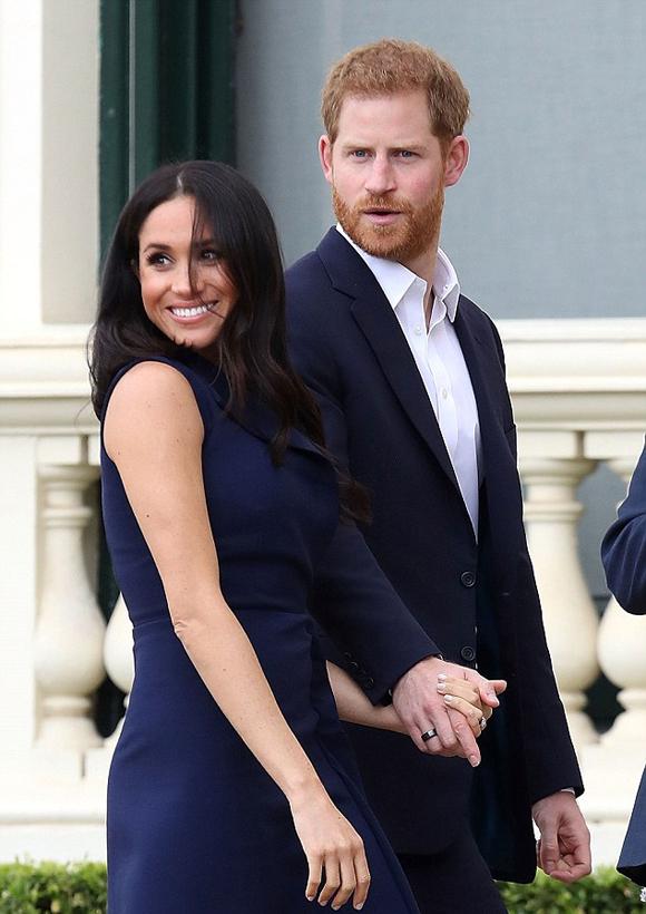 Hoàng tử Harry và vợ bầu Meghan tại sự kiện ở Melbourne sáng 18/10. Ảnh: WireImage.