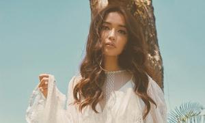 Bích Phương môi dày, tóc xoăn trong MV mới