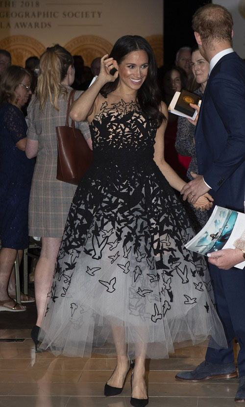 Meghan, who was wearing an exquisite Oscar de la Renta cocktail dress worth £10,000, clutched the toy as the couple left the ballroom after attending the Australian Geographic Society gala awards at the Shanghai-La hotel.
