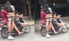 5 cô gái đu bám xe máy lao vun vút trên phố Hà Nội