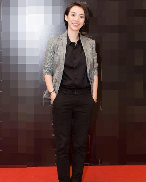 Diễn viên hài Thu Trang cá tính với kiểu tóc và trang phục tomboy khiến ông xã Tiến Luật ũng phải là anh trai.