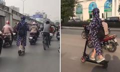 'Nữ Ninja' lái scooter lao vun vút trên phố Hà Nội