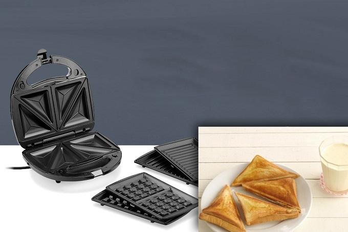Máy làm bánh 3 trong 1 Tiross TS513: giá từ 890.000 đồng, giảm còn 639.000 đồng. Sản phẩm có hai loại vỉ nướng, vỏ ngoài được cách nhiệt. Máy còn có tay cầm với khóa an toàn, đĩa phủ lớp chống dính giúp bánh được nướng tiếp xúc đều với vỉ hơn. Ngoài ra,Tiross TS513còntrang bị đèn tín hiệu báo bánh nướng chín, bộ điều chỉnh nhiệt tự động giúp bánhkhông bị nướng quá chín gây khét. Sản phẩm dễ sử dụng, giúp bạn chuẩn bị bữa sáng nhanh chóng và tiện lợi. Ngoài ra, thương hiệu Tiross cũnggiảm giá nhiều mặt hànghấp dẫn khác.