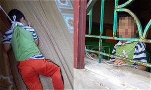Bé trai tự kỷ bị cô giáo buộc dây vào cửa sổ