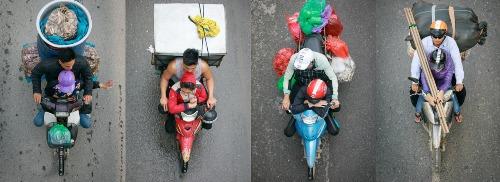 Hình ảnh quen thuộc của những đôi vợ chồng làm nghề buôn bán mưu sinh bằng xe máy.