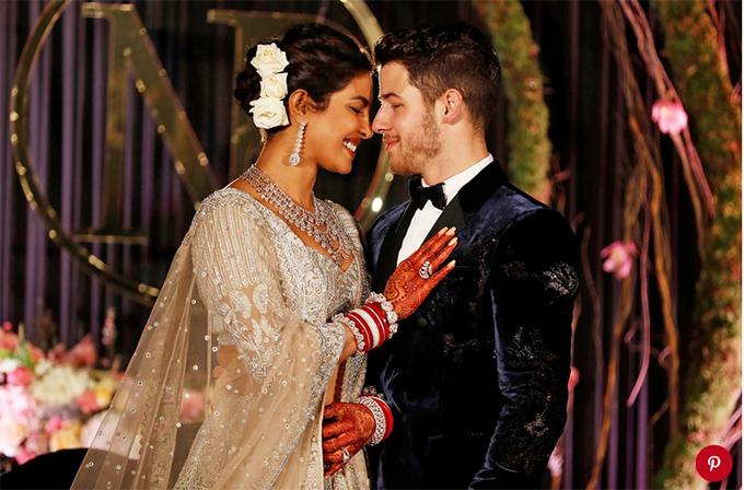 Cô dâu và chú rể rạng ngời hạnh phúc trong tiệc cưới ngày 4/12.