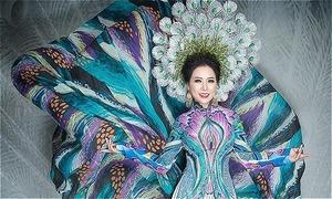 Hoa hậu Kristine Thảo Lâm diện áo dài họa tiết chim công
