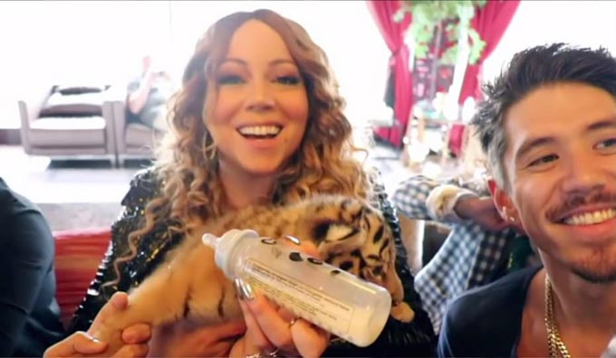 The zoo receives attracts A-List celebrities from around the world who Rashed names the animals after. Pictured, Mariah Carey with her tiger namesake. The teenagers YouTube channel and Instagram page offer a glimpse into his lavish lifestyle