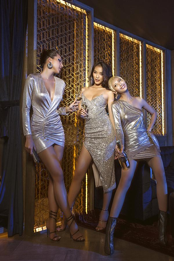 Chất liệu ánh kim hot trend của mùa thu đông 2018 được thương hiệu Việt thể hiện một cách lôi cuốn trên từng mẫu váy áo.
